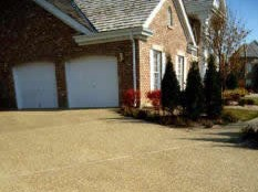 Can a resin gravel driveway be overlaid over an existing driveway?